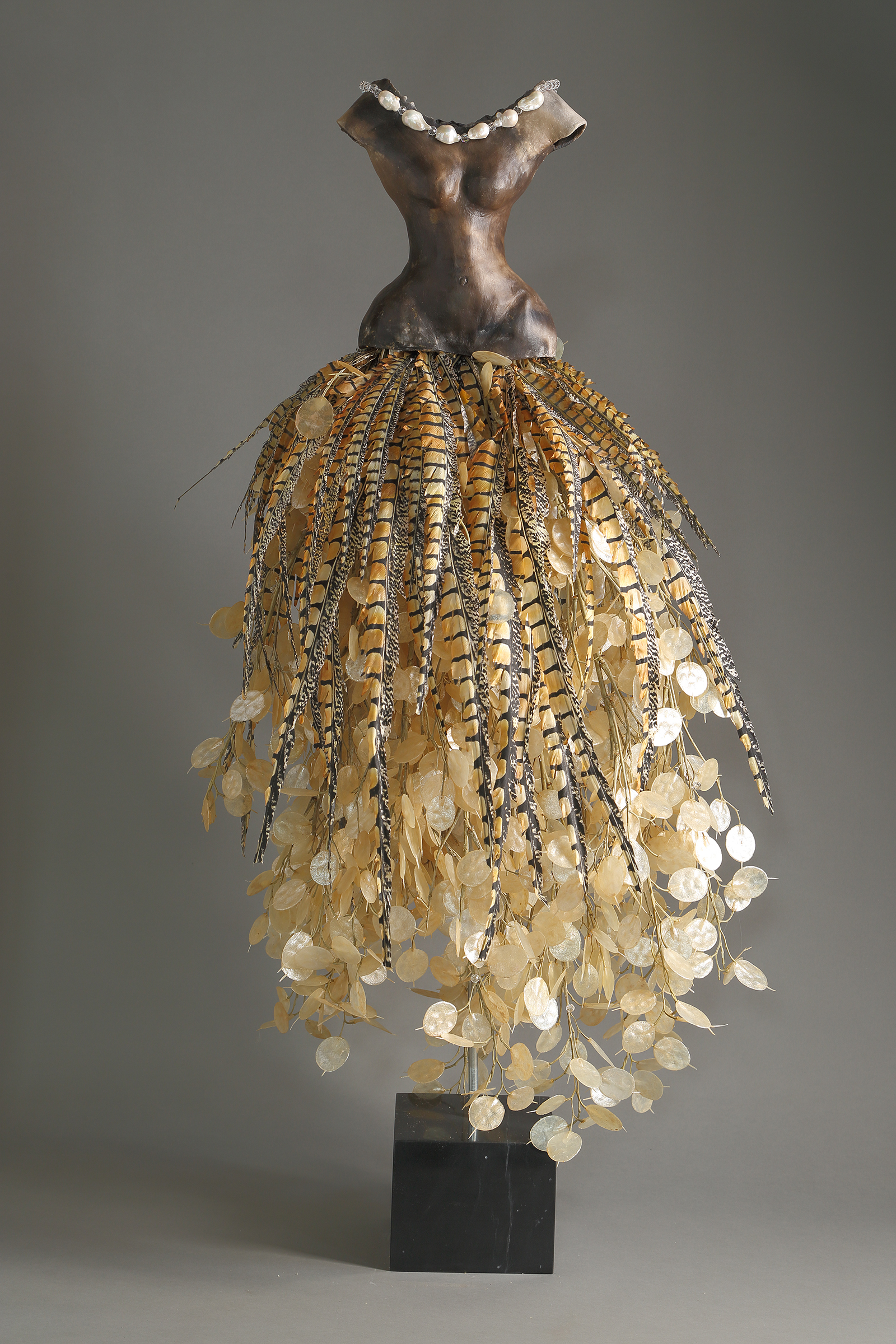 Estella Fransbergen - Sawdust Fired with Silver Dollar and Pheasant Feathers